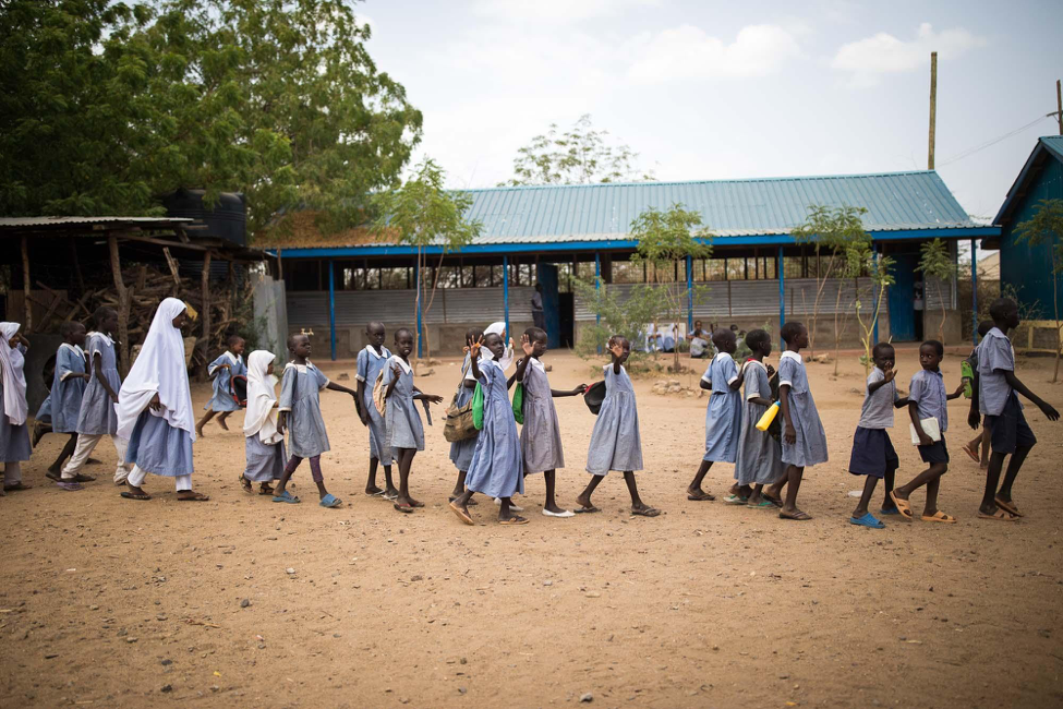 Girls walking to school in Kakuma refugee camp in Kenya © WUSC/ Lorenzo Moscia