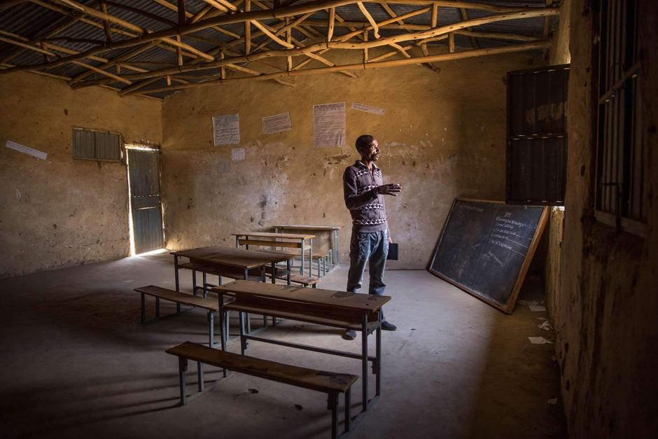 Teacher at empty school in Ethiopia, UNICEF/Ayene